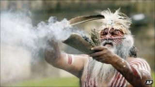 Aboriginal elder Major Sumner performs a smoking ceremony outside the World Museum following the return of an Australian indigenous human skull in Liverpool, England, 13 May 2009