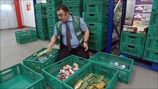 Man sorting food at depot