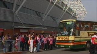 Southampton fans wait for coach