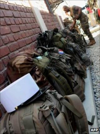 A French soldier checks his baggage before leaving the Torah base in Surobi district on 14 October 2011