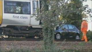 The car and the train on the Cliff's End level crossing