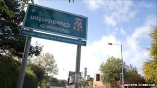 Upside down Welcome to Chadderton sign