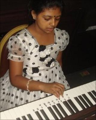 Bangladeshi schoolgirl with a piano donated by the South Korean company