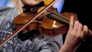 Youngster playing violin