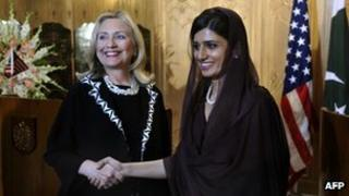 """US Secretary of State Hillary Clinton (L) shakes hands with Pakistan""""s Foreign Minister Hina Rabbani Khar after a joint press conference at the Pakistani Foreign Ministry in Islamabad on October 21, 2011."""