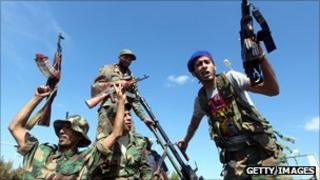NTC fighters celebrate in the eastern coastal city of Sirte following news of Gaddafi's death