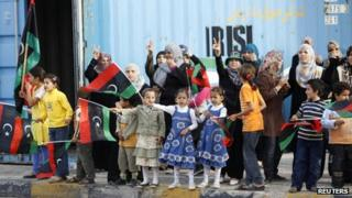 Libyans wave Kingdom of Libya flags in Misrata as they celebrate the demise of Muammar Gaddafi on 20 October 2011