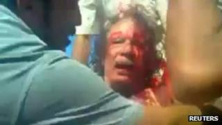 Still image from amateur video shot of Colonel Gaddafi after his capture in Sirte on 21 October 2011