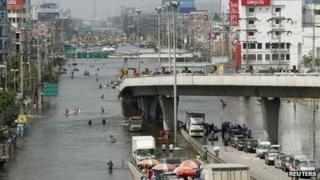 A flooded highway in a Bangkok district on 24 October 2011