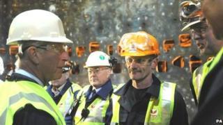 Prince Charles speaking to steel workers