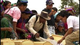 Indigenous Guatemalans identifying remains of massacre victims in 2001