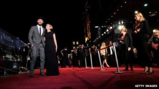 Jude Law and Sandra Hebron attending the opening night gala screening of 360 in Leicester Square