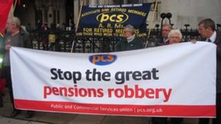 Public sector trade unionists protest outside a High Court hearing on the use of CPI instead of RPI to inflation proof their pensions.