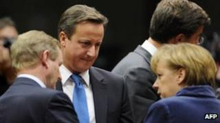 Prime Minister David Cameron (centre) talks with German Chancellor Angela Merkel
