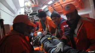 Rescuers with Ferhat Tokay