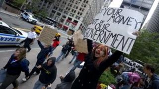 Occupy Wall Street protester holding a sign