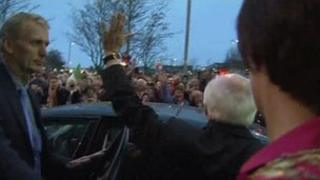 Michael D Higgins waved to supporters who had gathered in Galway city