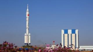 A Long March 2F rocket carries the Shenzhou 8 spacecraft at the Jiuquan Satellite Launch Centre on 26 October 2011 in Jiuquan, China