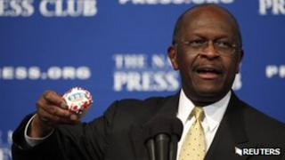 Republican presidential candidate Herman Cain speaks at the National Press Club in Washington, DC, 31 October 2011