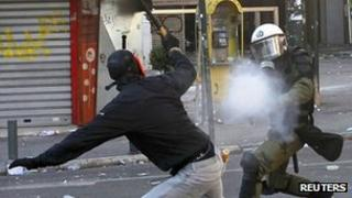 Policeman fires tear gas at Athens protester, 19 Oct 11