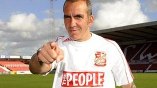 Swindon Town FC manager Paolo DiCanio models the FA Cup kit