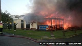 Firefighters tackle the blaze at the football club
