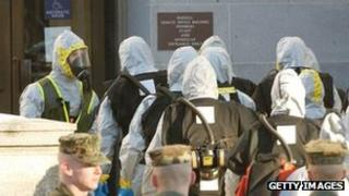 Hazmat workers enter the Russell Senate Office building on Capitol Hill 4 February 2004