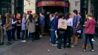 Fans queue up outside the Europa
