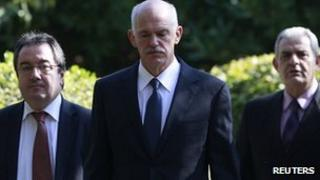 Greek PM George Papandreou at the presidential palace in Athens (5 Nov 2011)