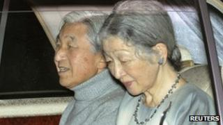 Japan's Emperor Akihito (L), with Empress Michiko, sits in a car on their way to a hospital in Tokyo on 6 November 2011