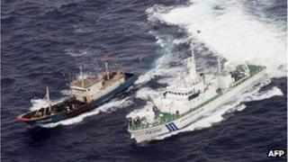 Handout picture taken by Japan Coast Guard on November 6, 2011 shows a Chinese fishing boat (L) being chased by a Japanese Coast Guard