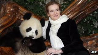 French Ecology Minister Nathalie Kosciusko-Morizet poses with a Giant Panda at the Giant Panda Breeding Centre in Chengdu, southwest China