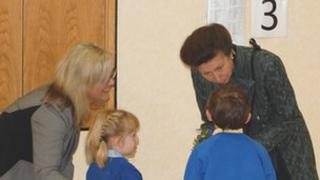Princess Anne being given a posy of flowers