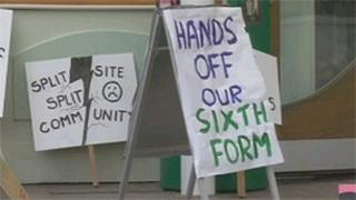 Banners outside meeting