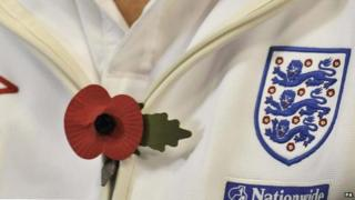 An England player wearing a poppy