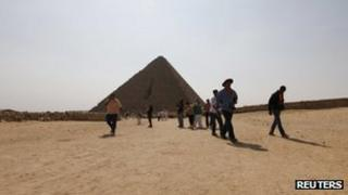Tourists visiting the Pyramids of Giza last month