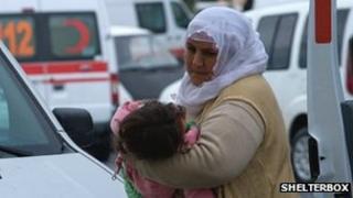 Mother carries child in Van, Turkey
