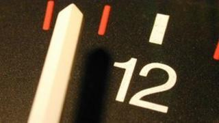 Clock hands close to 12