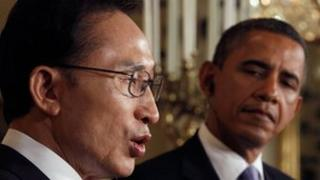 US President Barack Obama listens as South Korean President Lee Myung-back speaks in Washington on 13 October 2011