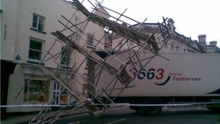 Scaffolding resting on the back of the lorry