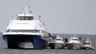 Coastguard boats rescue passengers from the Kartepe ferry
