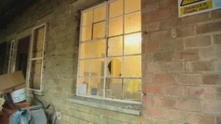 Smashed window at a depot in Derby