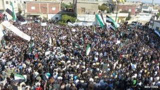 Opposition supporters rally in the Syrian town of Hula, 13 November