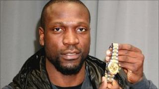 Ex-Arsenal footballer Lauren with his Rolex watch