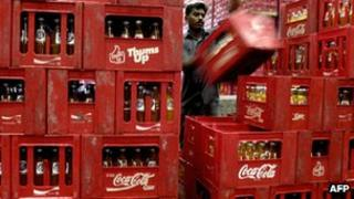 Coke bottles being stocked