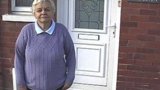 Enid Jones outside her house