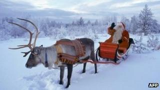 Santa Claus and reindeer in Rovaniemi