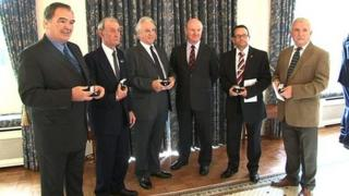 Veterans receiving badges from Guernsey's Lieutenant Governor