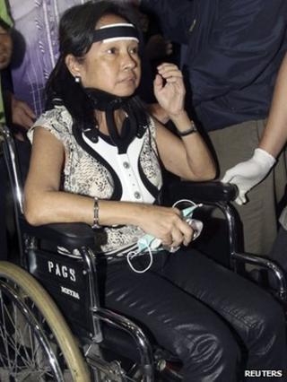 Former Philippine President Gloria Arroyo at Ninoy Aquino International Airport in Manila on 15 November 2011