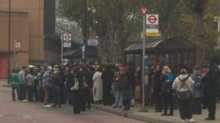 Passengers waiting for a bus in Leytonstone